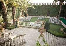 Outdoor wedding ceremony in the gardens of Castello Monaci in Puglia