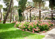 Outdoor wedding reception in the gardens of Castello Monaci in Puglia