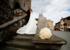 Bridal couple in front of Castellina in Chianti historical town hall