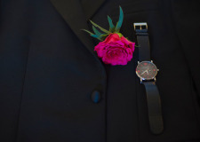 Boutonniere with fuchsia rose