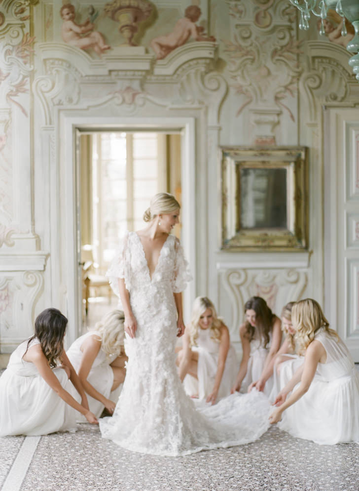 Bride and bridesmaids in the frescoed hall