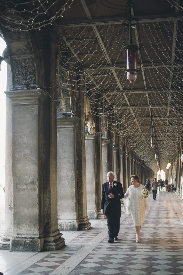 Bridal couple under St. Mark's Square arcades
