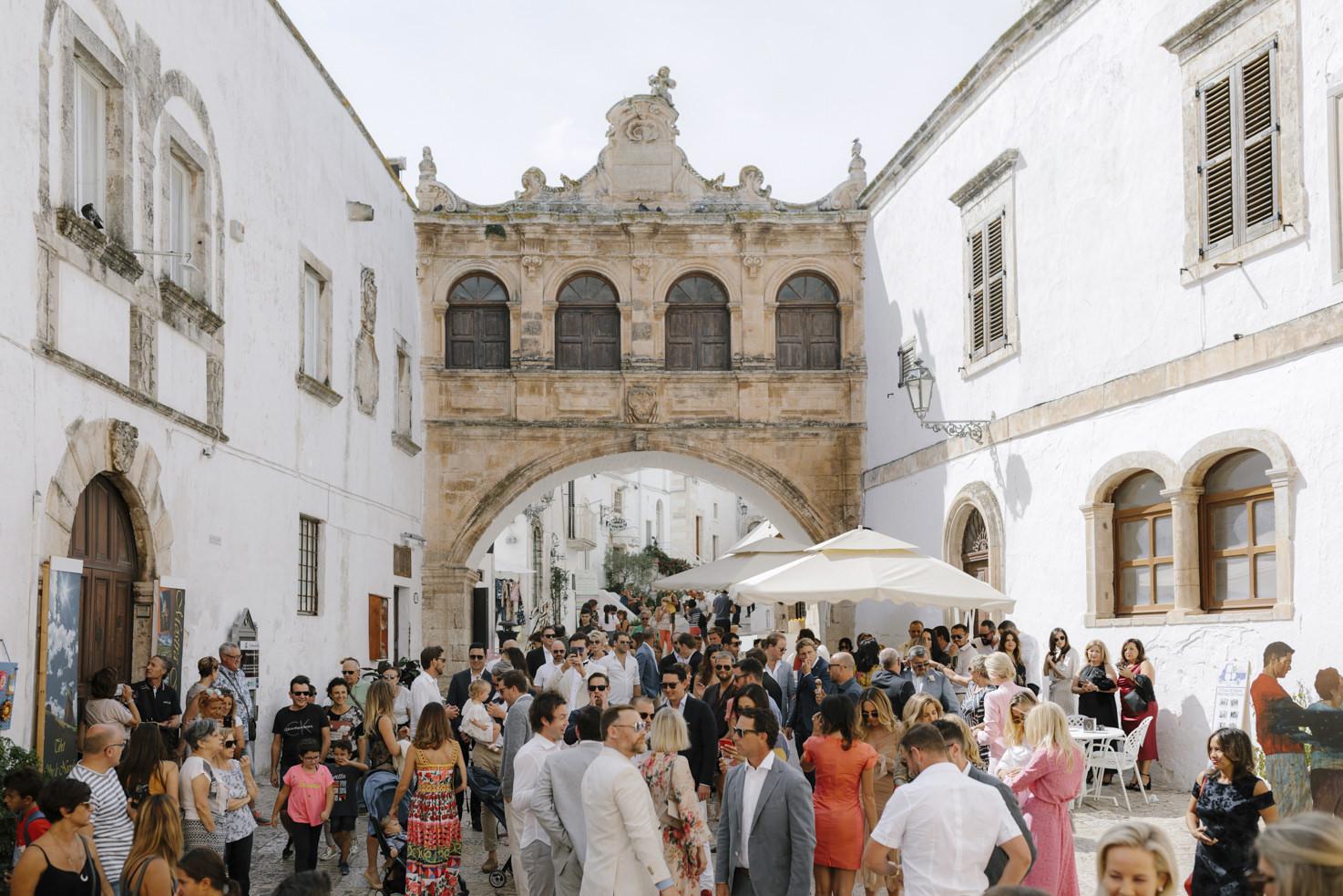 Wedding guests in a square in Ostuni