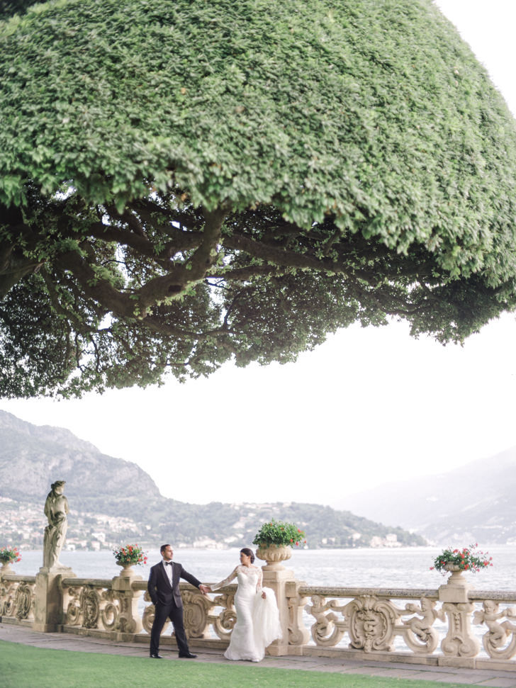 Bride and groom in the gardens of the villa