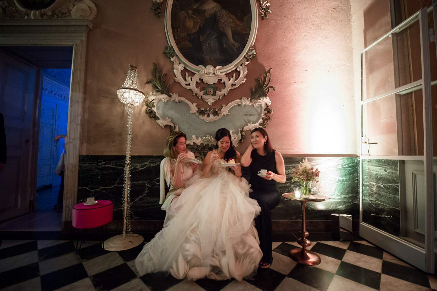 Bride and guests in a hall of Villa Pizzo