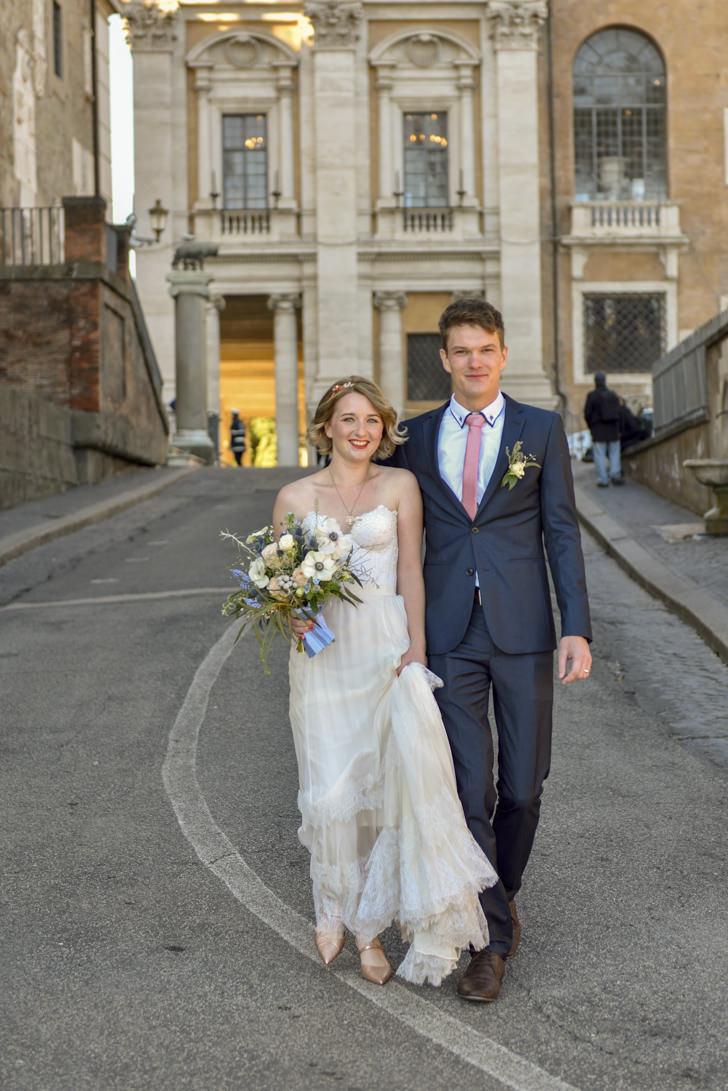 Newlyweds in front of Campidoglio Palace