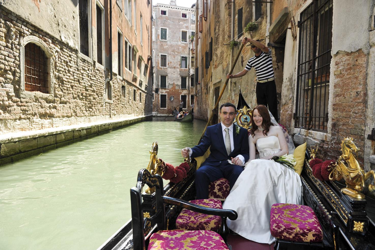 Bride and groom on a gondola