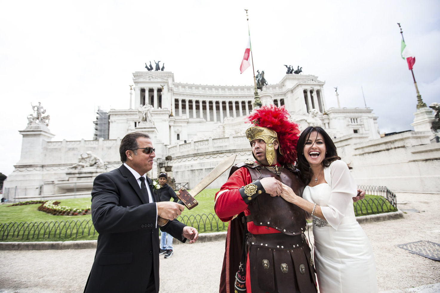 Bride and groom with a Roman centurione