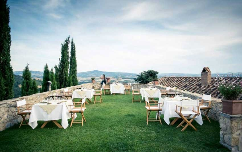 Outdoor wedding reception at Castello di Vicarello in Tuscany