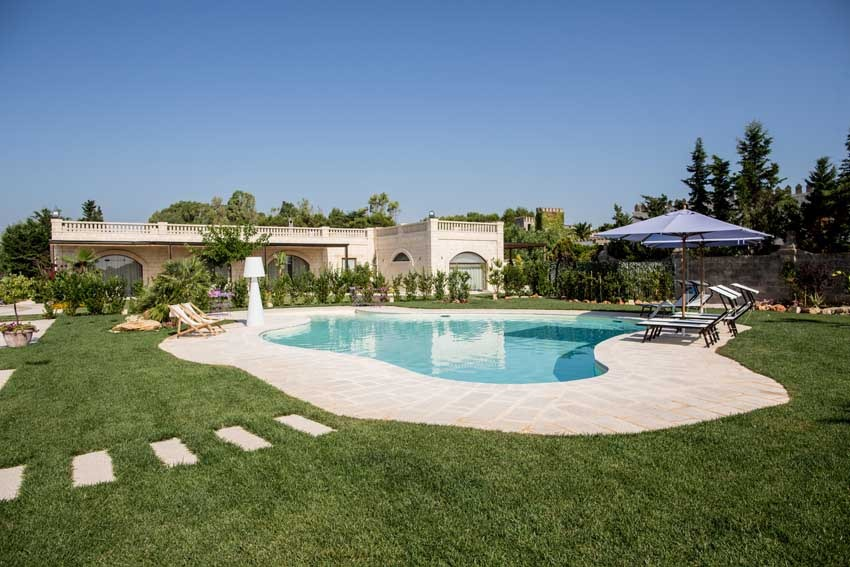Pool and gardens of Castello Monaci in Puglia