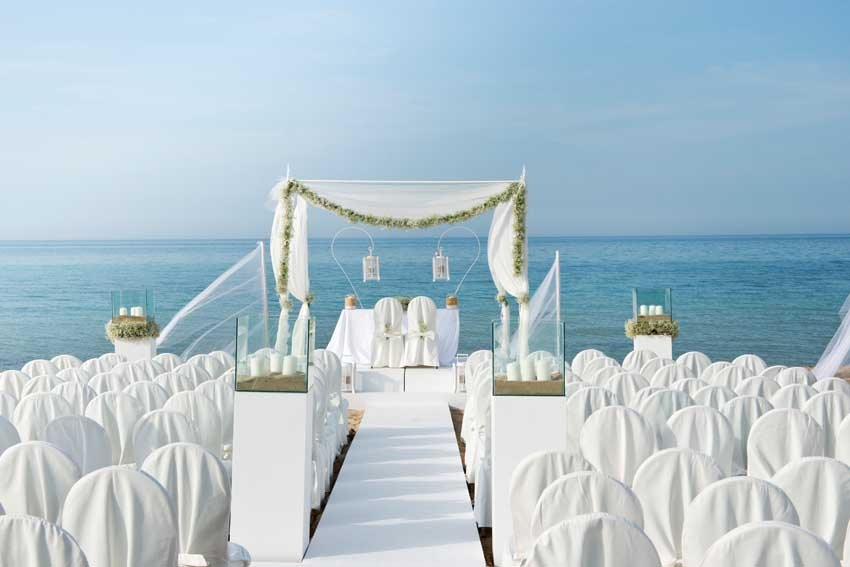Outdoor wedding ceremony at Torre Coccaro in Puglia