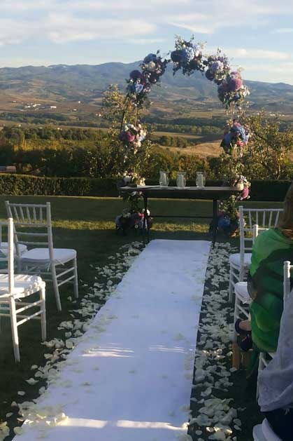 Outdoor ceremony at Castello Banfi for castle weddings in Tuscany