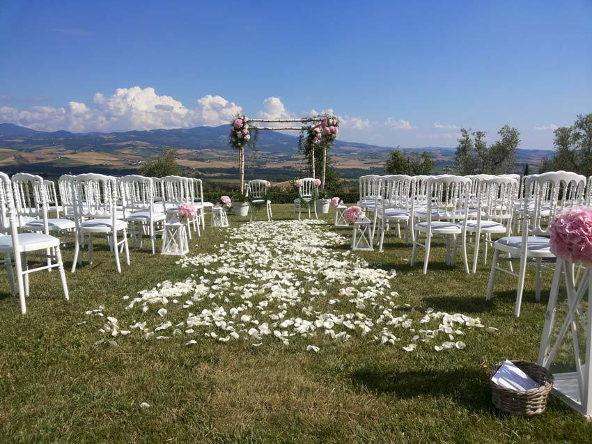 Outdoor wedding ceremony at Castello Banfi in Tuscany