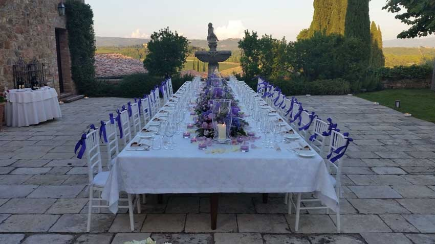 Outdoor wedding reception at Castello Banfi in Tuscany