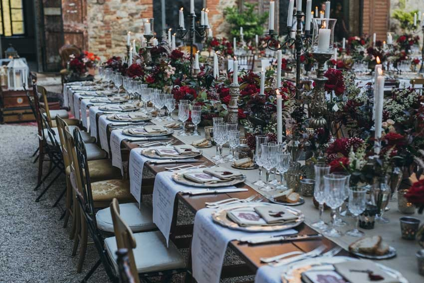 Outdoor wedding reception in the courtyard of Castello di Modanella in Siena Tuscany