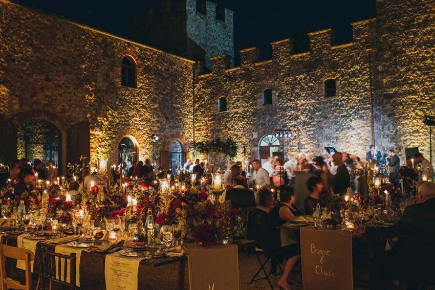 Outdoor wedding dinner in the courtyard of Castello di Modanella in Siena Tuscany