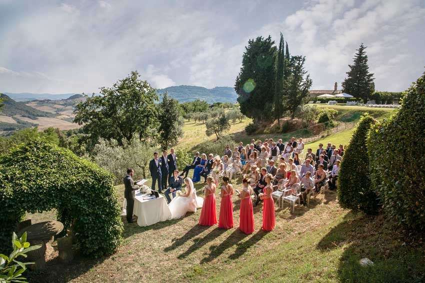 Outdoor wedding ceremony in Tuscany at Villa di Ulignano