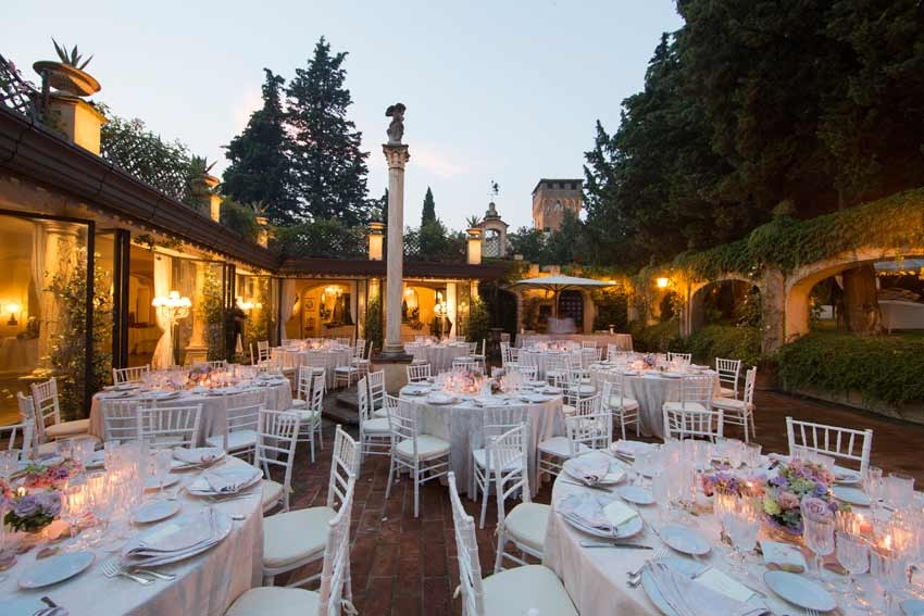 Outdoor wedding reception in the courtyard of Antica Fattoria Paterno in Tuscany