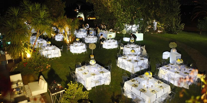 Outdoor wedding reception in the gardens of Villa Appia Antica in Rome