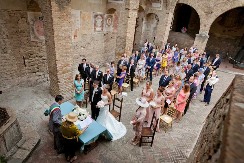 Civil wedding in historical courtyard in Tuscany, San Gimignano