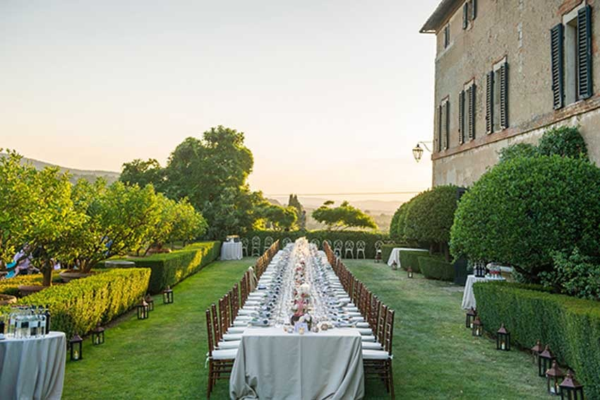 Outdoor wedding reception at Borgo Stomennano in Tuscany