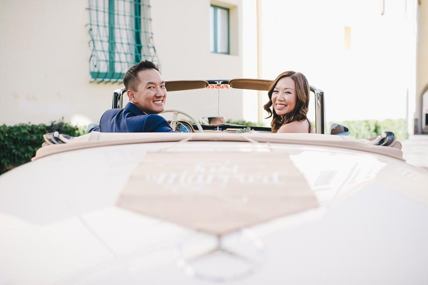 Bridal couple on vintage car in Ravello