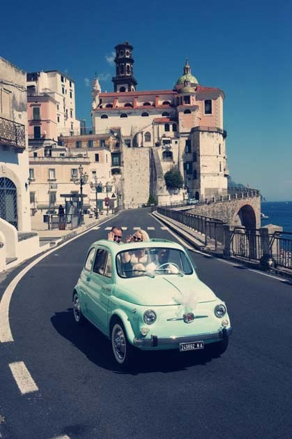Bridal couple on vintage car