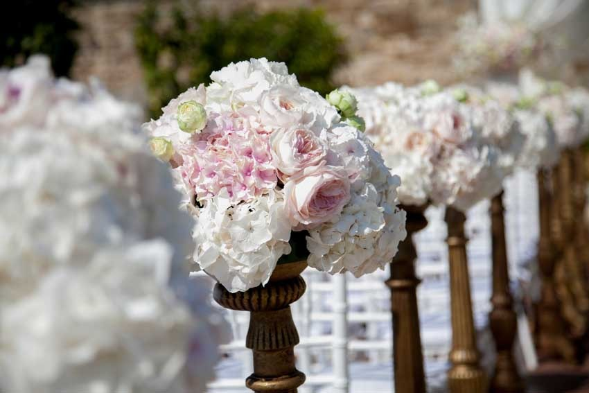 Aisle decor for wedding reception in a Tuscan castle