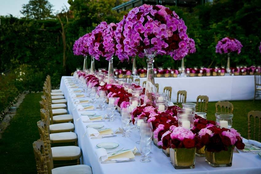 High floral design for outdoor wedding reception