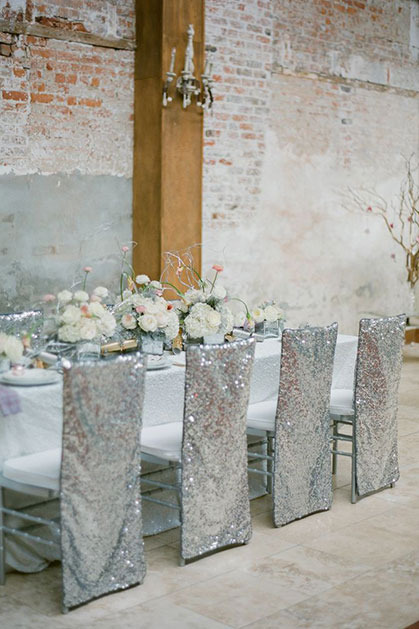 Wedding reception, chairs with glittering silver covers
