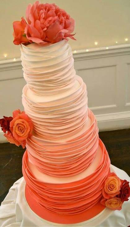 Ombré wedding cake decorated in orange hues