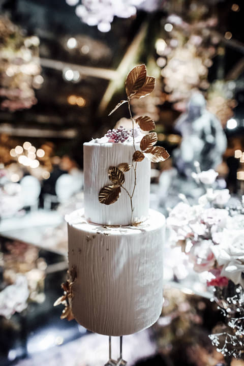 Wedding cake with gold leaves