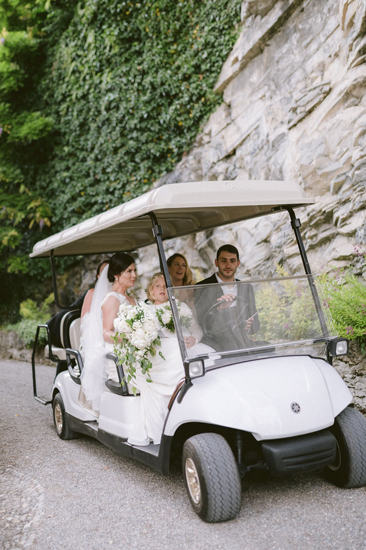 Arrival at the ceremony in a golf cart